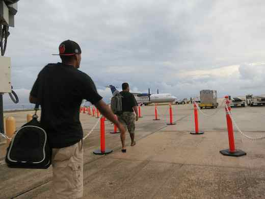 On the tarmac toward the last plane to Saipan.